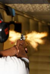Man firing weapon at bullseye shooting range tacoma